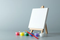 Painting easel with empty canvas Royalty Free Stock Photos