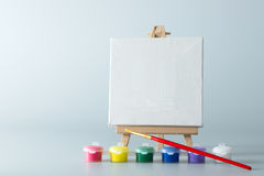 Painting easel with empty canvas Royalty Free Stock Photo