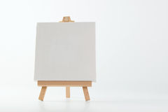 Painting easel with empty canvas. On white background royalty free stock photography