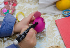 Painting easter egg by marker Stock Image