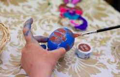 Painting easter egg by paintbrush Stock Photography