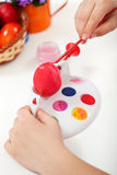 Painting the easter egg red Stock Photos