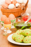 Painting Easter Eggs. With basket of eggs nestling in straw in background Royalty Free Stock Photography