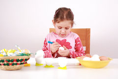 Painting Easter eggs. Cute little girl painting Easter eggs Stock Images