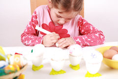 Painting Easter eggs. Cute little girl painting Easter eggs Royalty Free Stock Photography