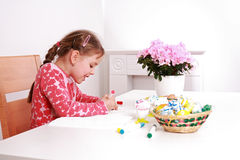 Painting Easter eggs. Cute little girl painting Easter eggs Stock Photos
