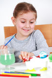 Painting Easter eggs. Cute little girl painting Easter eggs Royalty Free Stock Images