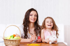 Painting Easter eggs. Happy mother and kid painting Easter eggs Stock Images