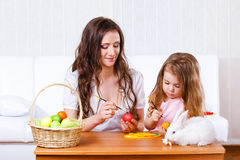 Painting Easter eggs. Mother and daughter painting Easter eggs Royalty Free Stock Photography