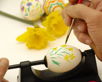 Painting easter eggs. Woman is painting easter eggs Stock Photos