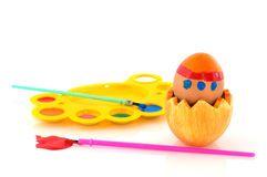 Painting easter eggs. With blue and pink brushes Stock Photos