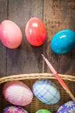Painting easter eggs. Basket, wood background Royalty Free Stock Photos