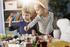 Painting the Easter eggs. Brother and sister painting Easter eggs Royalty Free Stock Photography