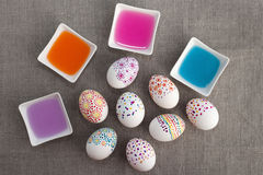 Decoration Easter eggs. Painting Easter eggs and colored water Stock Image
