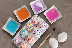 Painting Easter eggs. Colored water and brush Royalty Free Stock Photo