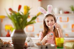 Painting Easter eggs. Female child painting Easter eggs Royalty Free Stock Images