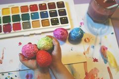 Painting of Easter eggs. stock photos