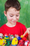 Painting Easter eggs Royalty Free Stock Images