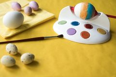 Painting Easter eggs with red brush. stock images