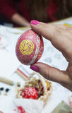 Painting Easter eggs. People paint Easter eggs at the table in the room Stock Photography