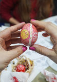 Painting Easter eggs. People paint Easter eggs at the table in the room Royalty Free Stock Images
