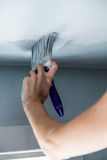 Painting the Edges of the Ceiling Stock Image