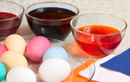 Painting eggs for Easter Stock Images