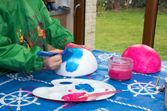 Painting eggs for easter Royalty Free Stock Image