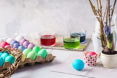 Painting eggs for Easter. Colorful eggs, paints and decoration stock images