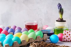 Painting eggs for Easter. Colorful eggs, paints and decoration. Painting eggs for Easter. Colorful eggs, paints and festive decoration. Spring holidays royalty free stock photos