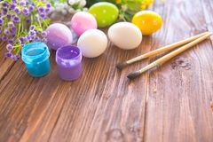 Painting eggs for easter holiday celebration Stock Image
