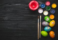 Painting eggs for Easter holiday on wooden table Royalty Free Stock Photos