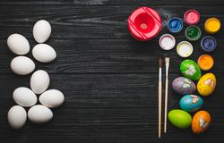 Painting eggs for Easter holiday on wooden table Royalty Free Stock Photography