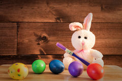 Painting the Eggs. An Ester Rabbit painting the eggs Royalty Free Stock Photo