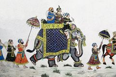Painting of elephant parade on Udaipur wall, India. Udaipur is famous for its paintings out of buildings. Here's one with an elephant parade. It's on an external Stock Photos