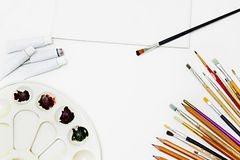 Painting equipment and blank white canvas. art Background, brushes Royalty Free Stock Photo