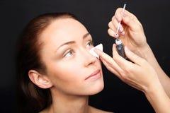 Painting eyelashes, permanent eye makeup Stock Photos