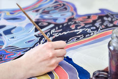 Painting on fabric. Hand painting on fabric,  a fragment of batik painting Stock Image