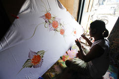 Painting on fabric. Craftsmen were making paintings on fabric in the city of Solo, Central Java, Indonesia stock photo