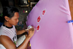 Painting on fabric. Craftsmen were making paintings on fabric in the city of Solo, Central Java, Indonesia royalty free stock photos