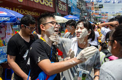 Painting faces. Bangkok, Thailand, 14 April 2015. Young people smear mud on each other's faces at Khao San Road during the Songkran street party. The annual Stock Photos