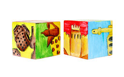 Painting on facets of wooden cube (side view) Royalty Free Stock Image