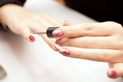 Painting of female nails Stock Photo