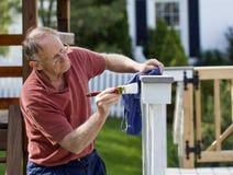Painting fence Stock Photo