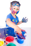 Painting with finger paints Stock Image