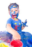Painting with finger paints Stock Photos