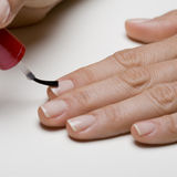 Painting fingernails Royalty Free Stock Photos