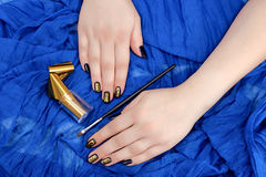 Painting fingers with dark blue nails Stock Images