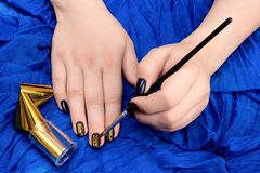 Painting fingers with dark blue nails Stock Photography
