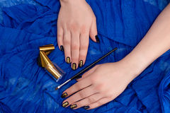 Painting fingers with dark blue nails Stock Photos